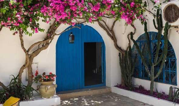 العرب اليوم - أفكار متنوعة لتصميمات مختلفة لأبواب المنزل الأماميّة