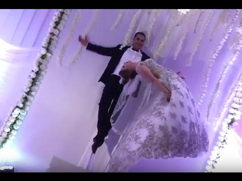 العرب اليوم - شاهد ساحر تونسي يطير بعروسه في حفلة الزفاف