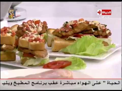 العرب اليوم - بالفيديو طريقة إعداد ومقادير سندويتش الدجاج المقلي بالموتزاريلا