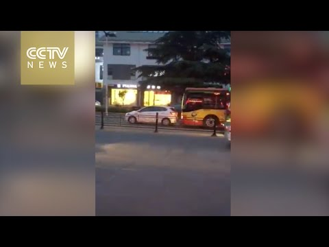bus driver intentionally hits car and runs over