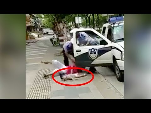 policeman throws woman holding a baby