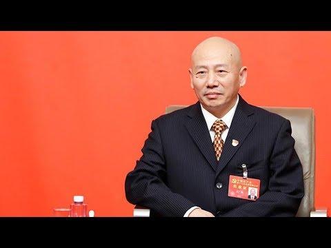 peking opera master sings during a group interview