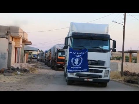 first aid convoy enters besieged city of houla