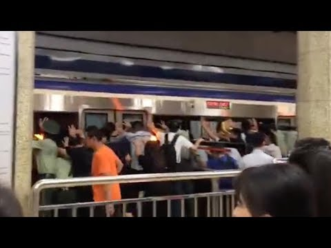 Arab Today, arab today pushing train to rescue trapped subway passenger