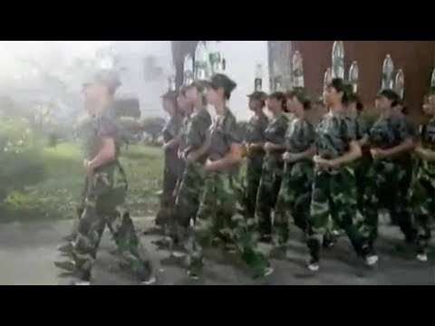 Arab Today, arab today cadets march while balancing water bottles