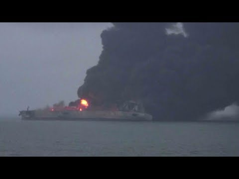 rescuers struggle to bring tanker fire under control