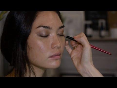 makeup artist applies organic solutions