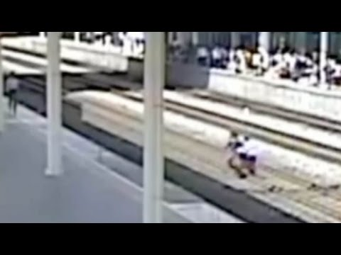 Arab Today, arab today footage man jumps on rail tracks
