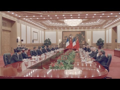 macron meets with xi as china