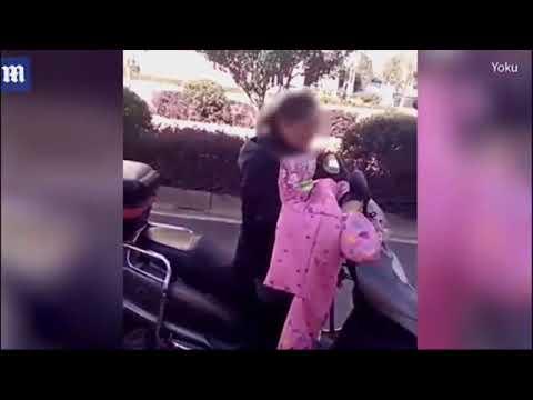 شاهد  أم تقيد ابنها قبل سحله بدراجتها النارية
