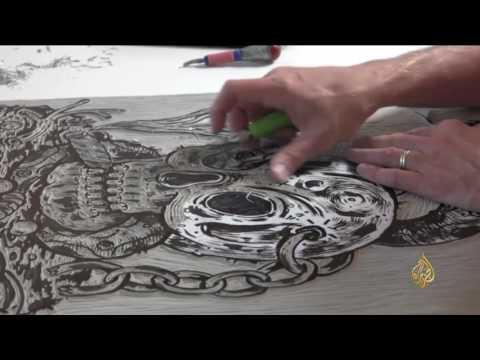 العرب اليوم - بالفيديو عرض رسومات يابانية على الخشب في معرض وارسو في بولندا