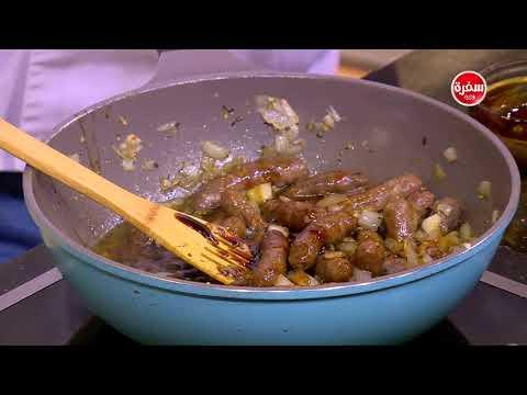 العرب اليوم - طريقة إعداد صينية بطاطس بالسجق والثوم