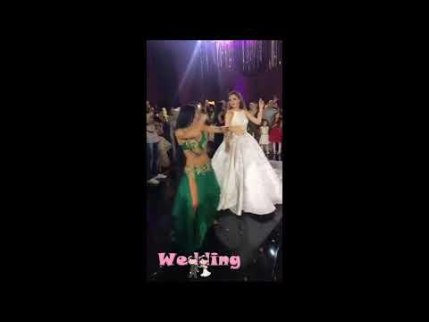 العرب اليوم - عروس تشعل فرحها بتحدي الراقصة وتخطف الأضواء منها