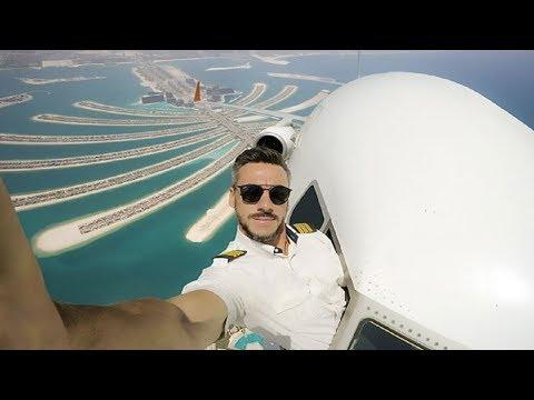 العرب اليوم - شاهد  طيار يُغامر بالتقاط صور سيلفي خطيرة