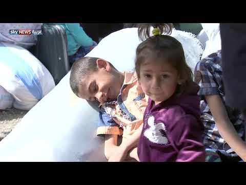 مئات اللاجئين السوريين يعودون إلى بلداتهم